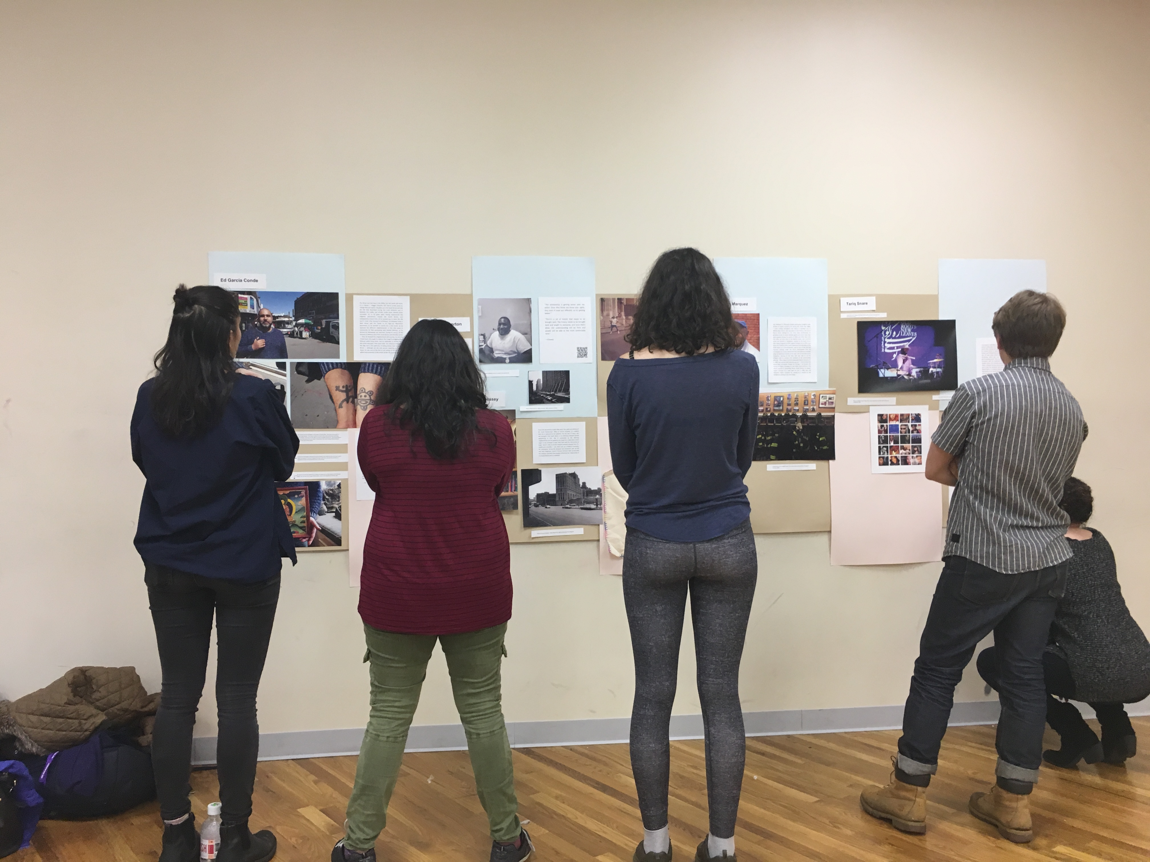 Students standing in front of their exhibit for Melrose Oral History Project, Spring 2017